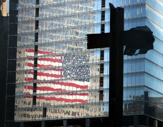 Girders in the shape of a cross, preserved from the wreckage of the World Trade Center (WTC), stand ..