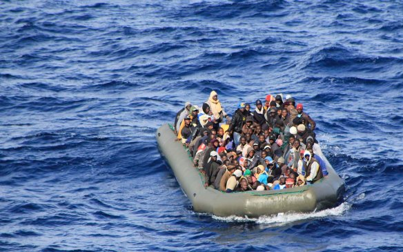 Migrants are seen in a boat during a rescue operation by Italian navy ship San Marco off the coast to the south of the Italian island of Sicily in this February 5, 2014 picture provided by the Italian Marina Militare. The Italian navy began the emergency sea rescue on Wednesday of an estimated 1,000 migrants from boats close to the island of Lampedusa, the site of a tragic shipwreck that killed hundreds five months ago, in the operation called Mare Nostrum.   REUTERS/Marina Militare/Handout via Reuters (ITALY - Tags: SOCIETY IMMIGRATION MARITIME) ATTENTION EDITORS - THIS IMAGE WAS PROVIDED BY A THIRD PARTY. FOR EDITORIAL USE ONLY. NOT FOR SALE FOR MARKETING OR ADVERTISING CAMPAIGNS. THIS PICTURE IS DISTRIBUTED EXACTLY AS RECEIVED BY REUTERS, AS A SERVICE TO CLIENTS
