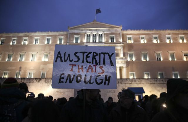 greece_austerity_protest_sign_ap_img.jpg
