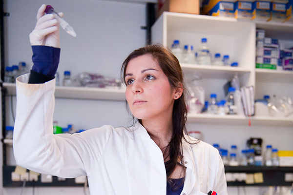 female+researcher+inspecting+tube.jpg